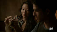 3x15 Kira shows Scott how to use chopsticks