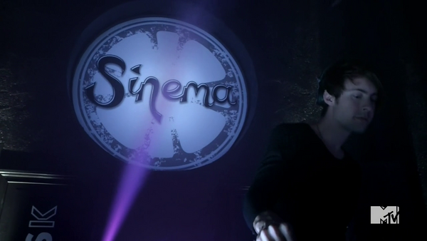 Teen Wolf Season 5 Episode 4 Condition Terminal Sinema Dance Club DJ sign.png