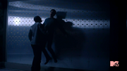 Teen Wolf Season 3 Episode 2 Bank Vault Sinqua Walls Tyler Posey Scott McCall and Boyd fight.png