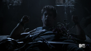 Teen Wolf Season 4 Episode 11 A Promise to the Dead Scott tied with straps and wolfsbane.png