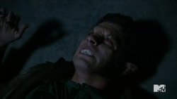 Teen Wolf Season 5 Episode 9 Lies of Omission Scott down.png
