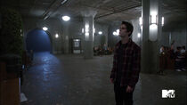 Dylan-O'Brien-Stiles-standing-by-board-Teen-Wolf-Season-6-Episode-10-Riders-on-the-Storm