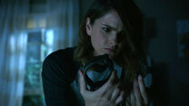 Shelley-Hennig-Malia-examines-chains-Teen-Wolf-Season-6-Episode-2-Superposition