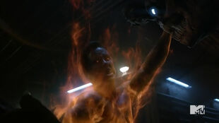 Teen Wolf Season 5 Episode 20 Apotheosis Parrish holding the beast