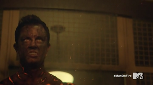 Teen Wolf Season 5 Episode 15 Amplification Parrish fangs eyes and fire