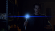 Teen Wolf Season 3 Episode 19 Letharia Vulpina Stiles with Ultrasonic emitter.png