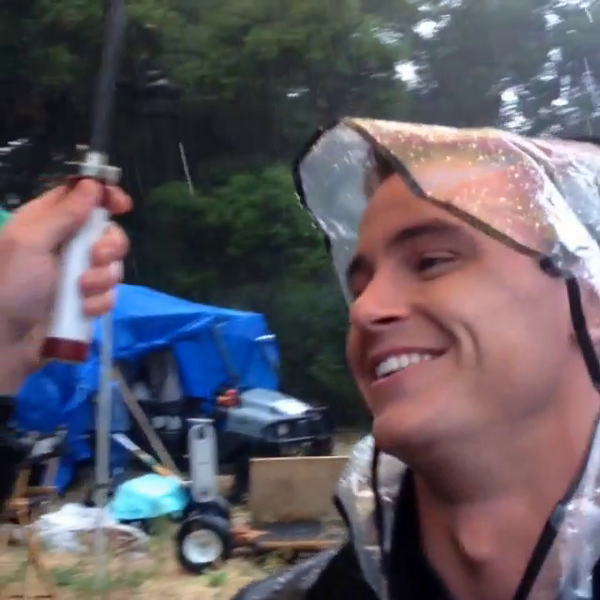 Teen Wolf Season 5 Behind the Scenes Ryan Kelley rain hat.png