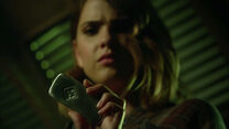 Shelley-Hennig-Malia-holding-Argent-artifact-Teen-Wolf-Season-6-Episode-9-Memory-Found