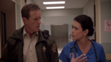 160px-Teen Wolf Season 3 Episode 7 Currents Linden Ashby Melissa Ponzio Sheriff and Melissa McCall investigate.png