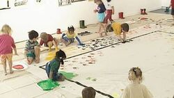 The children painting with their hands and feet.jpg