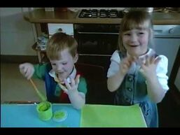 The two children make paintings of fish with their hands.jpg