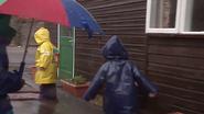 Children splashing by the puddles