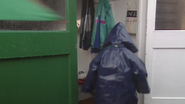 Little Boy walking inside while getting splashed through the door