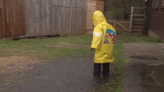 Joseph splashing into a muddy puddle