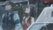 Natsumi watches as the rain starts again