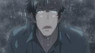 Keisuke watches as the rain starts again