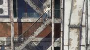 Hodaka runs to the top of the building