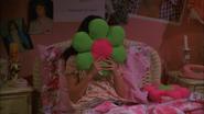 Green petals red disc flower pillow