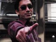 Shinji-mikami-shoots-you-with-gun