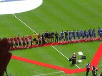 The two teams line up prior to kick-off