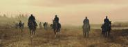 Guardians riding the horses