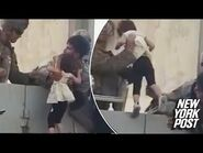 Video shows child being hoisted over wall amid Kabul airport chaos - New York Post