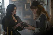 Salem-Promo-Stills-S2E04-08-Mary Giving Book of Shadows to Anne