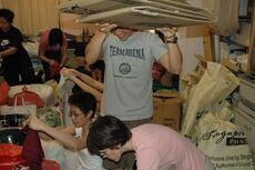 Volunteers packing the donated goods into bags and cartons.