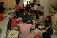 Concerned volunteers sorting through donated goods.