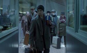 S05E01-Mischa at airport.jpg