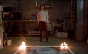 The Summit episode Elizabeth watches painting burn.png