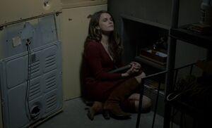 S01E13-Liz listens to Mom tape.jpg