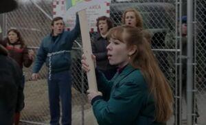 S02E13-Paige protesting.jpg