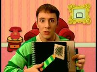 Steve with black notebook
