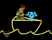 Steve and Blue in Chalk Water with a boat