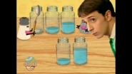 Mr Salt with a spoon tapping jars of water