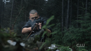 Shaw fires his weapon in 512