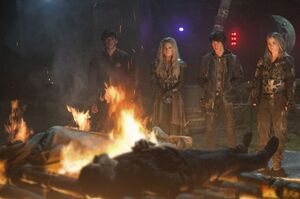 Bellamy, Clarke, Monty and Harper at the funeral (S2E12)