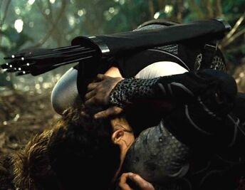 Китнисс целует Пита на арене ТКБ