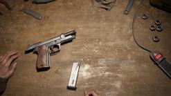 Pistol with slider pulled back