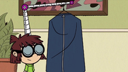 S4E14B Lisa hums while carrying a suit