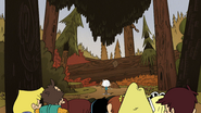 S5E18 They find themselves in front of a giant log covered in dirt