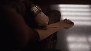 Julia cuts her arm