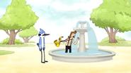 S6E11.115 Sad Sax Guy Taking Money From the Park Fountain