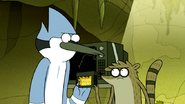 S6E19.170 Mordecai and Rigby Holding the Game Cartridge