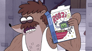 S6E27.036 Sherm Holding the Cereal