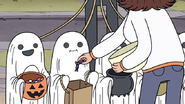 S3E04.192 Halloween Mom Giving Out Candy