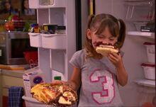 Chloe thunderman eating birthday cake.JPG