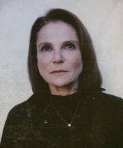 Deanna en su atuendo característico en la Temporada 6.