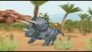 Linny, Tuck and Ming riding a dinosaur